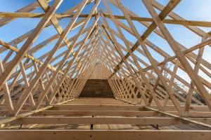 Wood house truss against blue sky